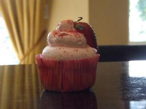 Strawberry cupcake with strawberry Swiss meringue buttercream. 2013.